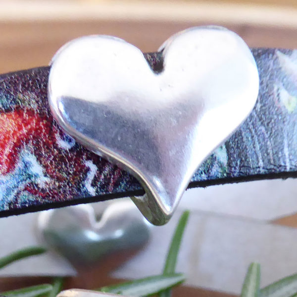 Add Silver Heart Charm to  one of our leather bracelets: Rainbow Marble Swirl Leather Bracelet Metallic Pearl Bronze Leather Bracelet Order each separately.
